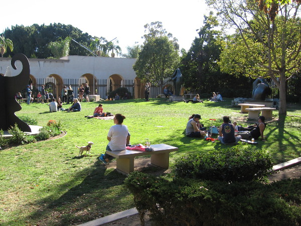 Many enjoy sitting in sunshine at the San Diego Museum of Art's May S. Marcy Sculpture Garden.