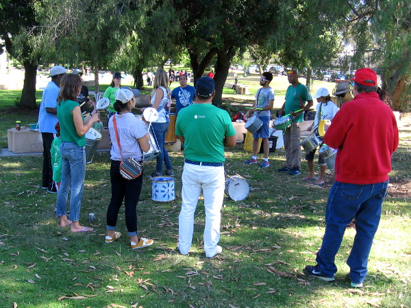 I noticed some of the Super Sonic Samba School drummers were wearing green out on the grass by the WorldBeat Cultural Center.